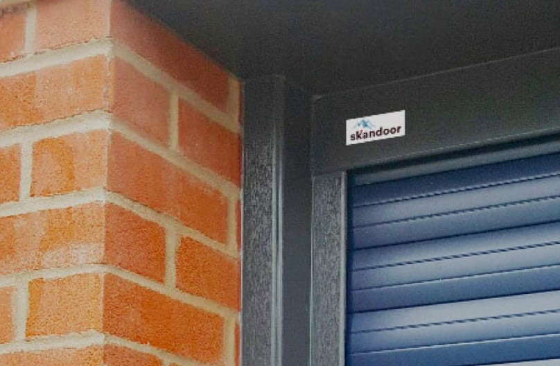 Anthracite and Blue Roller Garage Door